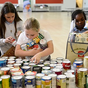 Kids sorting canned food.