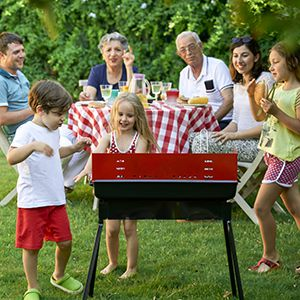 Family grilling in the backyard