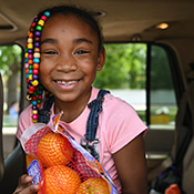 JaLisa holding oranges in her grandma's car