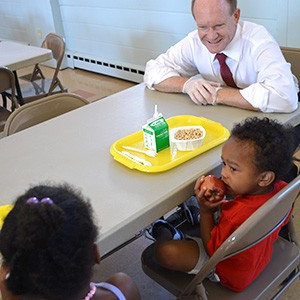 Senator Chris Coons from Delaware visiting a kids feeding program