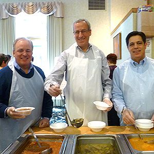 Political leaders in Pennsylvania serve a meal at a soup kitchen