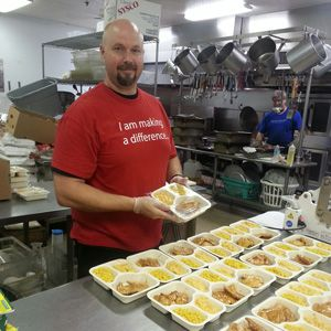 A BJ's team member volunteering at a food bank.