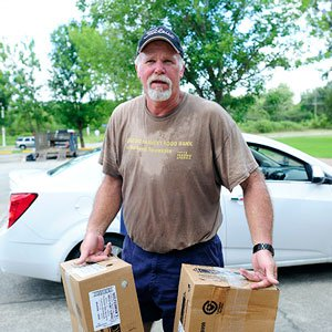 Chuck Burrell of Second Harvest Food Bank of Northeast Tennessee helps with recovery efforts.