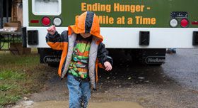 A child in front of a mobile pantry.