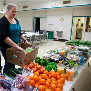 A woman helping at a diabetes management pantry.