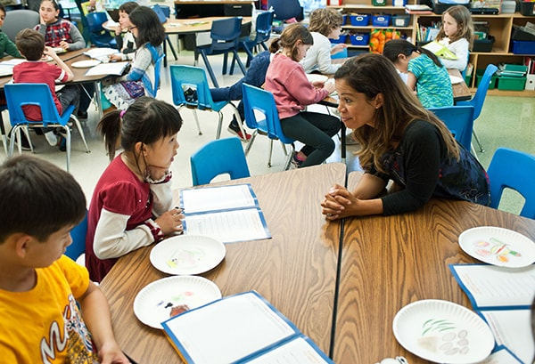 Mary helping one of her students through the Hungry to Help lesson.