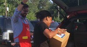 Feeding America employee Jordan Vernoy volunteering.
