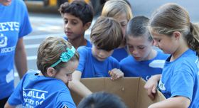 Children volunteering at a food bank.