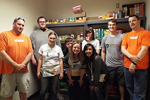 Students volunteering at a food pantry.