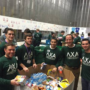 Lamda Chi members volunteering