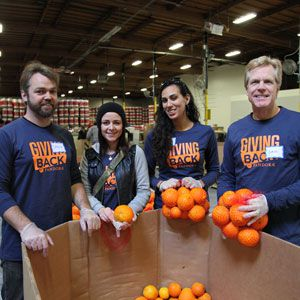 Volunteers with oranges in Oakland.