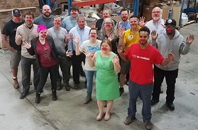 Food bank staff pose with their red noses