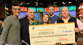 Disney presents a large check to Feeding America to help hunger-relief efforts