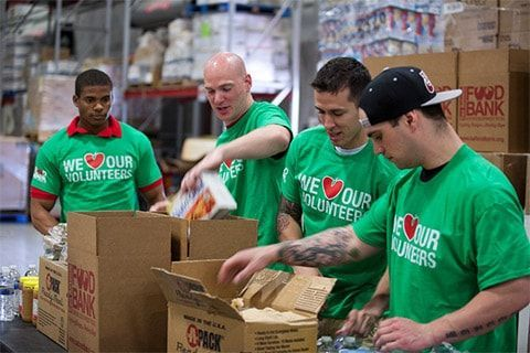 Food bank volunteers packing boxes