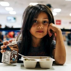 Girl at summer meal program in Arizona drinking milk