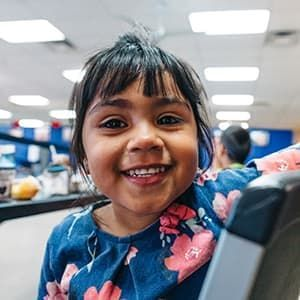 Genesis, 4, eats lunch at a summer meals program in Phoenix, Arizona.