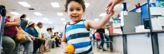 Juan Alfredo, age 2, eats an orange at a summer meals program in Phoenix, Arizona.