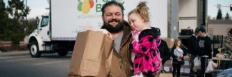 Martin and Rylee picking up food from mobile food bank
