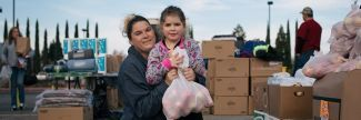 Mom and daughter at food bank after disaster