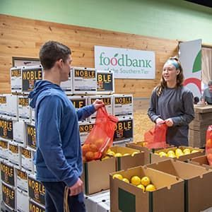 Volunteers at Food Bank of the Southern Tier in Upstate New York packing emergency food boxes
