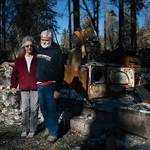 Couple outside home burned in wildfire