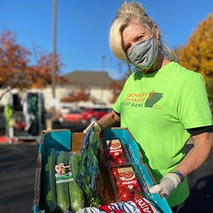 A volunteer at a Mobile Pantry hosted by Northwest Arkansas Food Bank