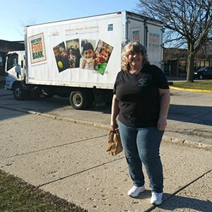 Tammy volunteering outside of Northern Illinois Food Bank
