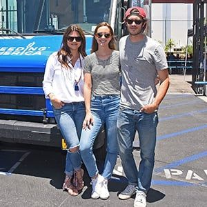 Tiffani Thiessen, Leighton Meester and Adam Brody pose in front of Feeding America's ice cream truck.
