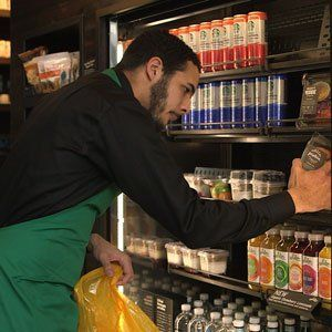 A Starbucks employee collecting food to be donated.