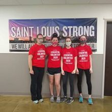 Mother and daughters volunteering at food bank