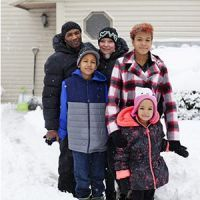 A family enjoys being together in the snow