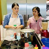 Two volunteers at food bank cooking class