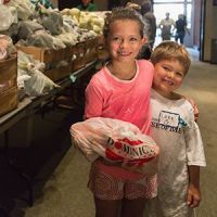 Kids hugging at food bank