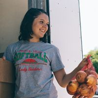 Food bank volunteer unloading produce from truck