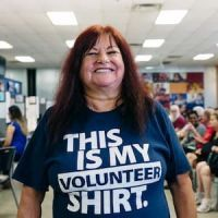 "Woman wearing a ""This is my volunteer shirt"""
