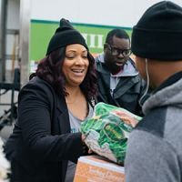 Baretta volunteers at a Thanksgiving food distribution at a school in Philadelphia.