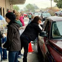 Volunteers and staff at Harvest Hope Food Bank in Richland County, South Carolina, distribute food at a drive-up distribution.